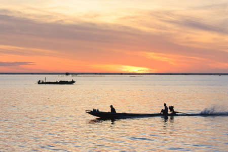 Fisherman in fishing boat,Southern Thailand,morning time photo