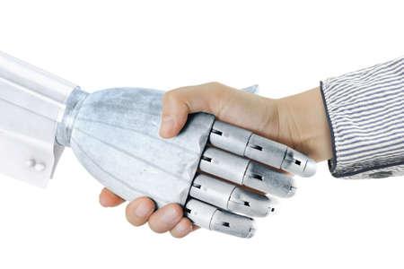 robot: apret�n de manos de mujer con mano robot aislada sobre fondo blanco Foto de archivo