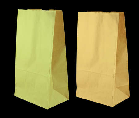 olive green and yellow color paper bags isolate on black photo