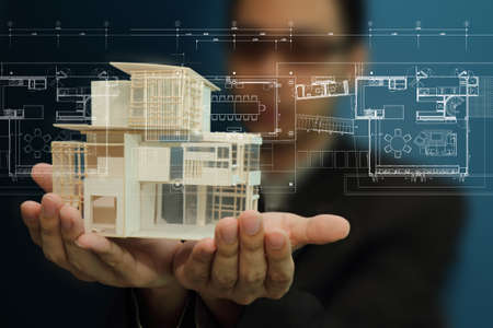 architecture model: Businessman present house model and plan on touch screen Stock Photo