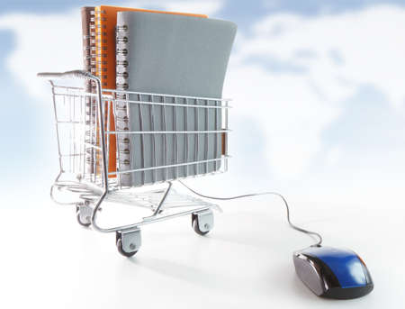 computer mouse and shopping cart and book, concept of online education and business Stock Photo - 10530647