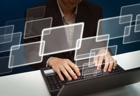 Business man working with laptop and virtual buttons as e-mail,business copy Stock Photo - 10530659