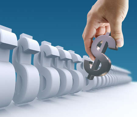 Business hand pick the right dollar sign on blue background Stock Photo - 10530694