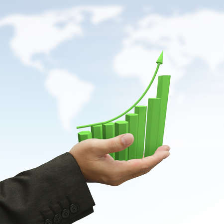 Business hand hold rising green graph on blue sky background photo