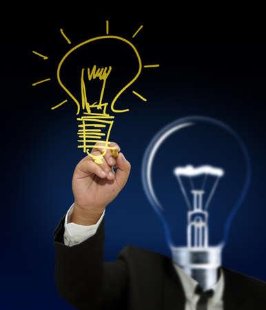 Businessman bulb head hand with a pen drawing light bulb photo