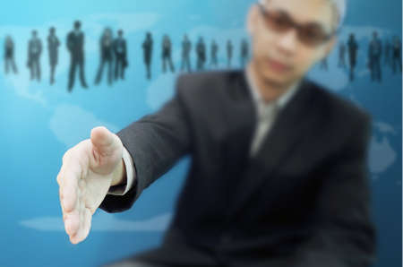 Executive extending hand to shake Stock Photo - 10693538