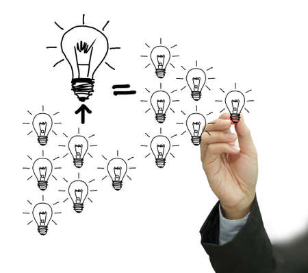 business hand draws many bulbs as concept on whiteboard Stock Photo - 10739457