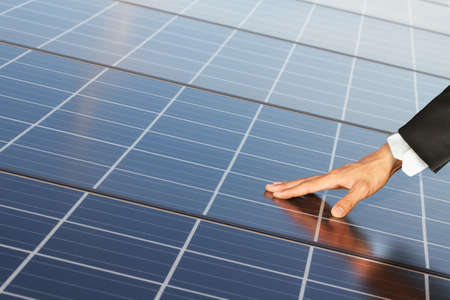 solar symbol: Business Hand touch renewable energy systems