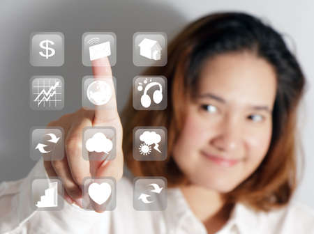 business woman pressing a touchscreen button Stock Photo - 11122487