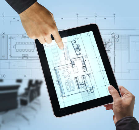 architect tools: business hand point on interior layout plan on tablet computer as meeting concept Stock Photo