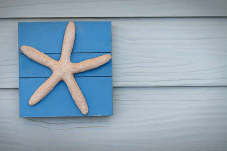 A blank notice board with a seaside or beach theme. photo