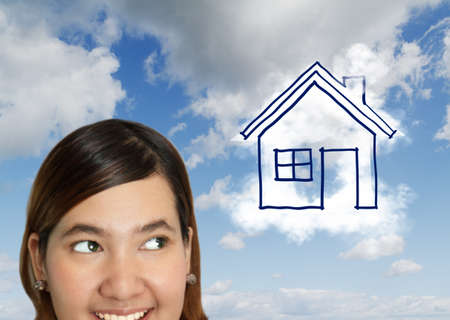 dream house: Happy house buyer  owner concept or woman dreaming of a house