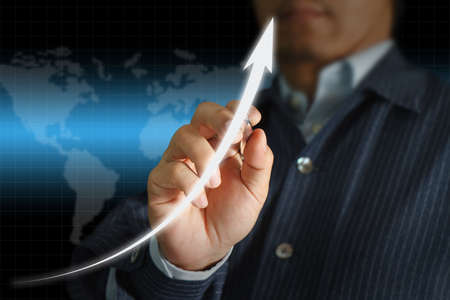 Male hand drawing a graph on world map background Stock Photo - 11321609