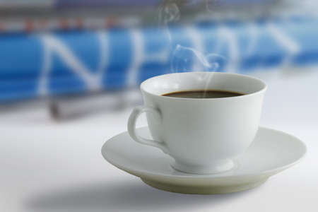 stock news: a coffee cup and newspaper background Stock Photo