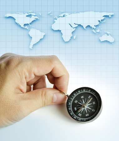 compass in the hand,map in the background Stock Photo - 11321621