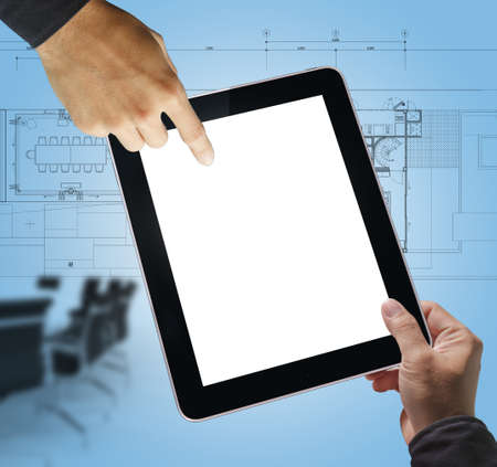 architectural designs: business hand point on blank tablet computer as meeting concept Stock Photo