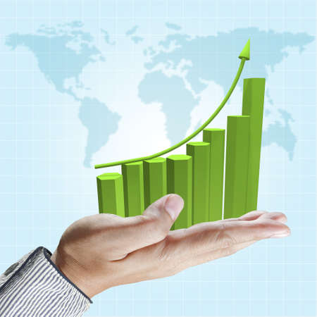 column chart: Business hand hold rising green graph on blue sky background