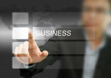 businessman pushing business word on a touch screen interface. Stock Photo - 11321593