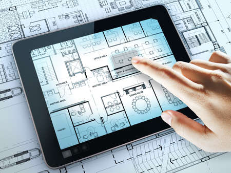 business hand point on interior layout plan on tablet computer as meeting concept Stock Photo