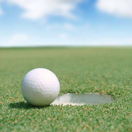 golf stick: golf ball on green Stock Photo