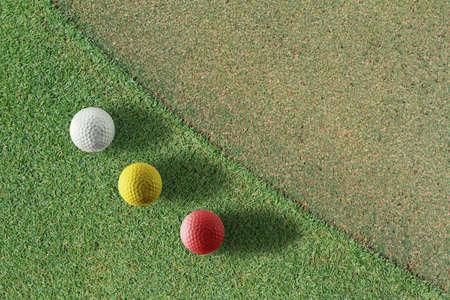 red,yellow.white golf balls photo