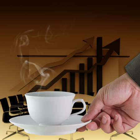 hand with a cup of coffee ,conference table background photo