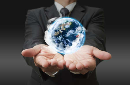 hands holding the earth globe in his hand Stock Photo - 11575428