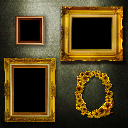 Gallery display - vintage gold frames on an old timber wall photo