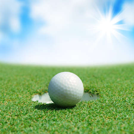 play golf: golf ball on green course near the bunker