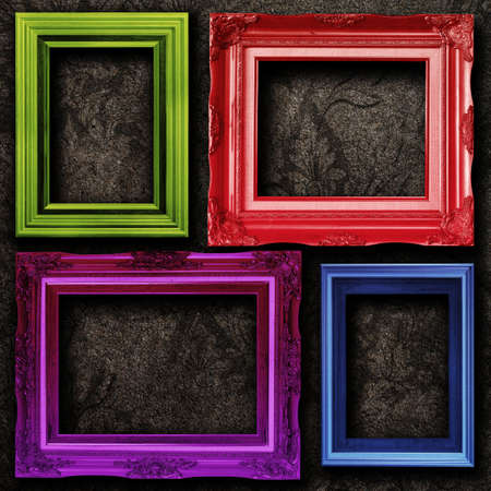 old picture frame: Four contemporary picture frames vibrant colors on dirt wall background