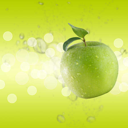 green apple on green water background photo