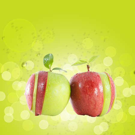 green and red  apple on green water background photo