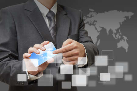 Businessman hand holds touch screen mobile photo