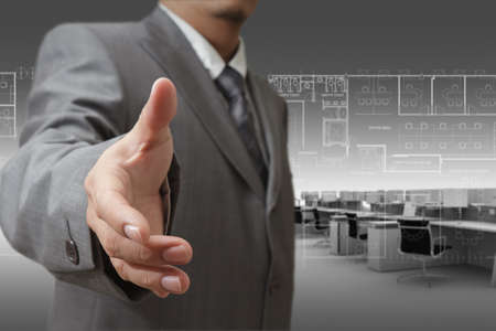 Businessman and office workstations background photo