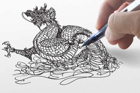 hand draws dragon on paper Stock Photo - 11739401