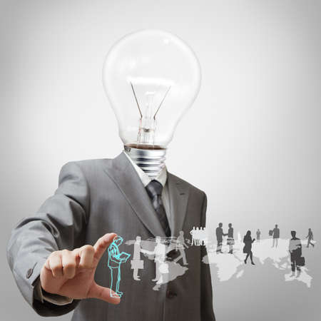 high tech design: Businessman with light bulb head and employees Stock Photo