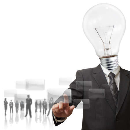 hightech: business light bulb hand pushing on a touch screen interface Stock Photo