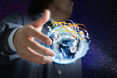 Businessman hand holds globe and social network on space background Stock Photo - 11844140