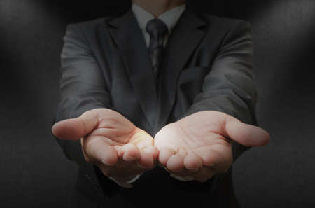 cupped: business man hands open Stock Photo