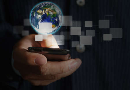 close up of touch screen mobile phone in businessman hand and light grow up Stock Photo - 11931197