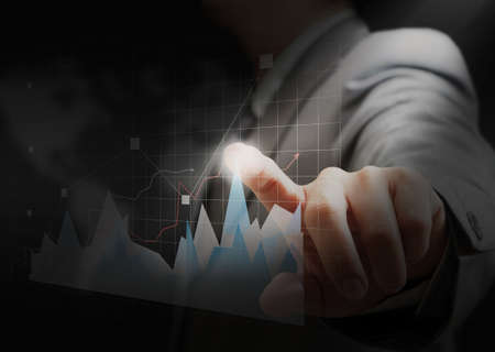increment: Stock Photo: businessman hand touch virtual graph,chart, diagram on wold background Stock Photo