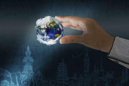atlas: businessman hand holding the dream travel around the world