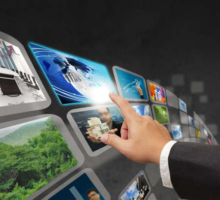 high definition: business hand reaching images streaming from the deep internet concept