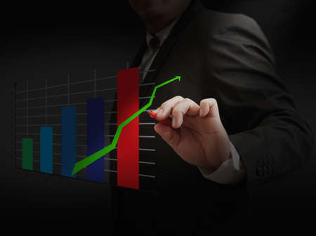 Male hand drawing a business chart Stock Photo - 11944596