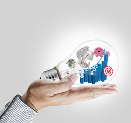 Light bulb in hand with business collection Stock Photo - 12001042