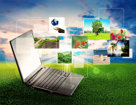 internet keyboard: volor collage of notebook against green nature background