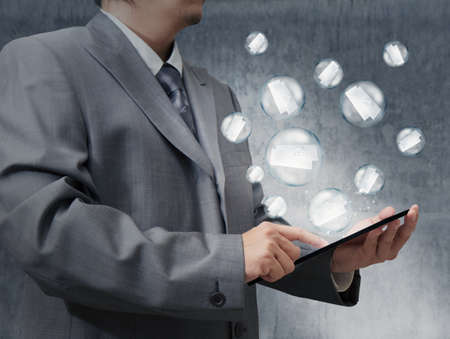 business hand use tablet computer with bubble email as concept photo