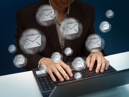 images icon: businessman working with laptop send email