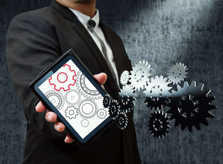 businessman and tablet show gear to success Stock Photo - 12246771