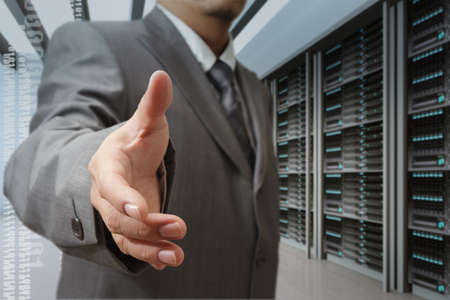 businessmen offer hand shake in a technology data center Stock Photo